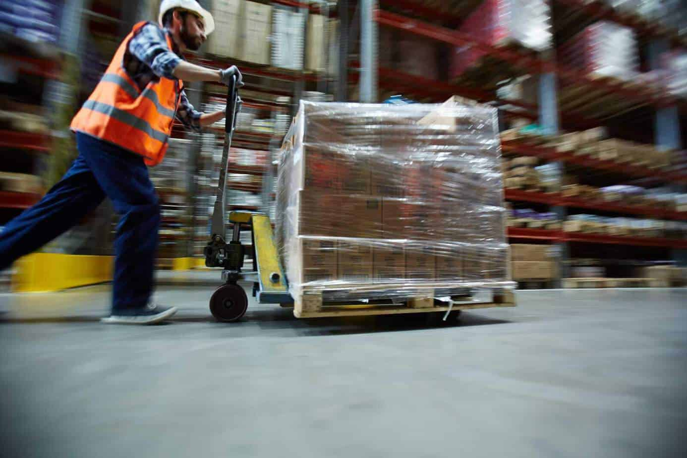 Image of distribution warehouse worker running to fulfill order