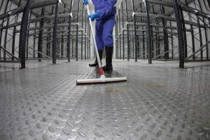 image of janitor cleaning floor